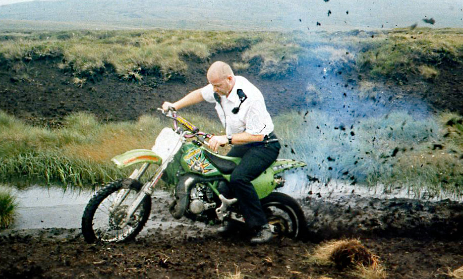 Trial-bike-with-policeman-in-reovery