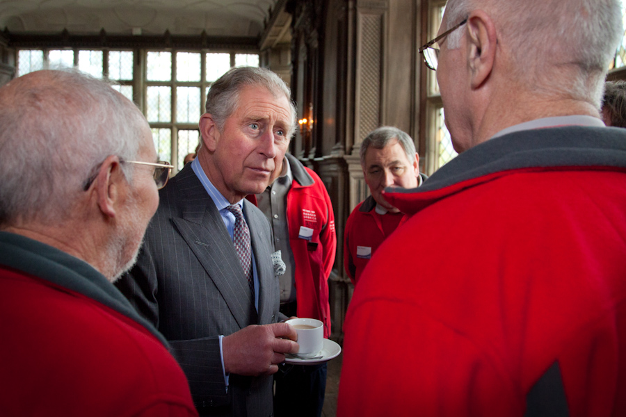 HRH the Prince of Wales talking to representatives of the volunteer rangers with over 40 years' service